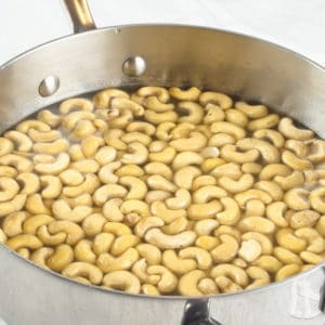 Sweet and Spicy Nuts Simmering the nuts in syrup