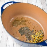 Indian Lemon Rice (Chitranna) spices sputtering in ghee in dutch oven