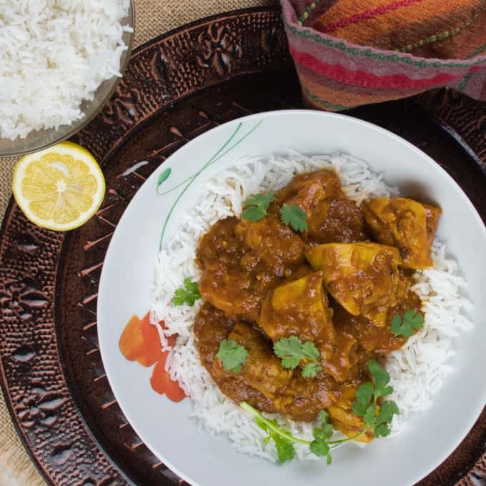 Easy Peasy Weeknight Curry Served with rice and showered with bright green cilantro and a wedge of lemon..