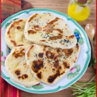 Homemade Naan (No-Yeast) Four naan served with a side of ghee.