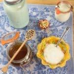 How to Make Homemade Yogurt (Stove) Homemade yogurt served with honey and nuts.