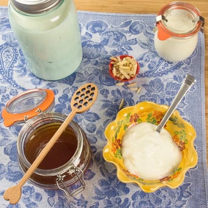 Finished homemade yogurt with honey and slivered almonds