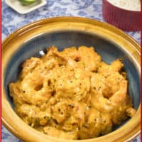 Bengali Prawn Curry (Chingri Posto) Creamy prawn curry ready for serving. with a wedge of lime on the side.