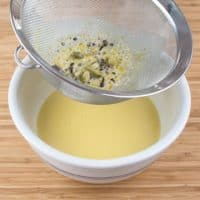 Sweet & Creamy Chai Pudding - Straining the egg and spiced cream mixture.