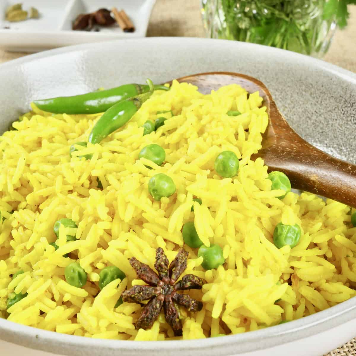 Goan=spiced rice is inished cooking in a dutch oven, ready for serving.