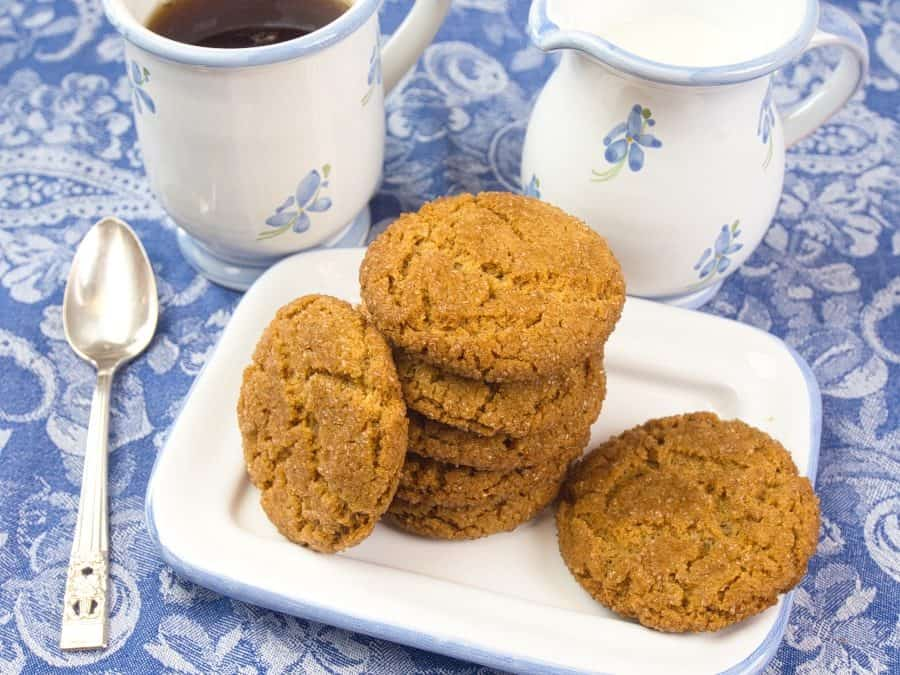 Cardamom Spice Cookies (Indian-ish) Browned, crackly cookies stacked beside a lovely cup of tea.