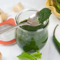 Green Chutney - 3 Easy Recipes All bright green and stored in a pretty lidded jar.