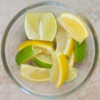 Lemon Pickle Recipe (Nimbu ka Achar) Lemon and limes cut in wedges.