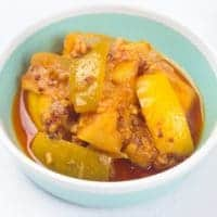 Lemon Pickle Recipe (Nimbu ka Achar) A small serving dish of a mixed lemon and lime pickle with Indian spices
