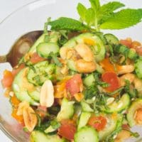 Indian Cucumber Salad (Kachumber) This colorful salad of cucumber and tomato is erved with a sprinkling of peanuts and chopped cilantro.