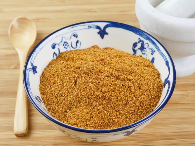 Tandoori Masala Recipe Roasted and finely ground spice blend in a pretty blue and white bowl for all your tandoori needs
