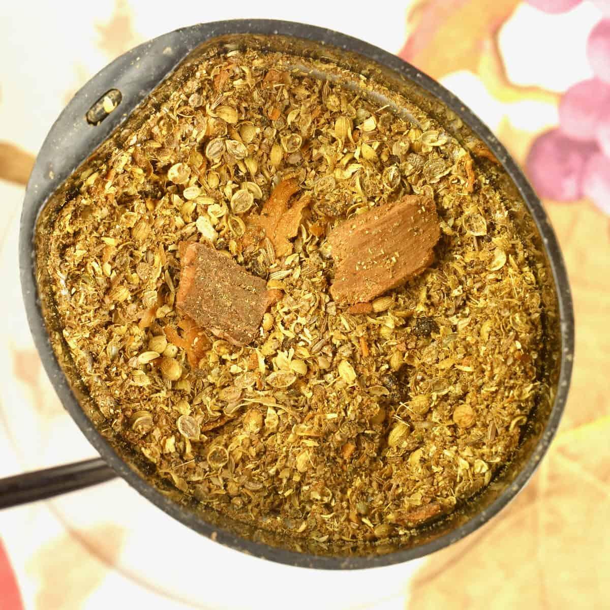 Grind the whole spice for the tandoori masala powder.