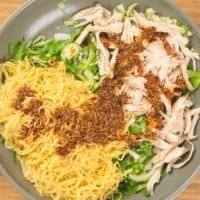 20-Minute Sichuan Noodles Noodles being combined with the sauce and the vegetables.