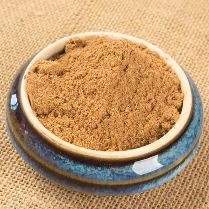 Chaat Masala Spice Mix all toasty and ground and ready for cooking in a pretty blue bowl