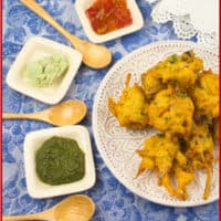 Potato Pakora inviting you to snack with three chutneys: coconut, cilantro and tamarind