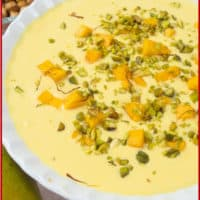 Luscious Mango Custard (Amrakhand) topped with candied pistachios, cubes of mango and lovely shreds of saffron.