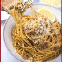 Indian Spaghetti Bolognese a bowl full of bolognese and a fork twirled full of perfectly coated pasta