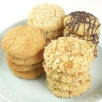 Chewy Coconut Almond Cookies (Gluten Free) plate of cookies dressed up with chocolate, coconut, spiced sugar, and nuts.