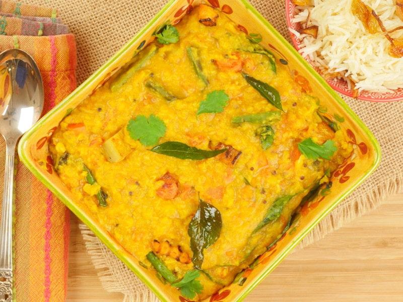 Sambar Recipe (Kerala) Served with flourish of toasted cashews, raisins and a ducting of coarsely chopped cilantro.