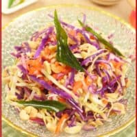 Indian-ish Coconut Cabbage Salad Served with a slice of lime, a small fresh chili, and extra peanuts on the side.