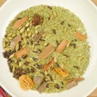 Kerala Garam Masala Whole spices toasting in a pan.