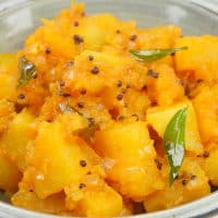 Aloo Masala (Kerala-Style) A beautiful bowl of aloo masala with popped mustard seeds and spluttered curry leaves.