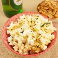 Easy Microwave Curry Popcorn Served with sweet and salty nuts and flavored with Indian spices.