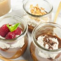 Vegan Chocolate Pudding Two Ways Dished out into cute Weck jars for individual servings and decorated 3 ways: raspberries and mint, coconut whipped cream with candied peanuts or shaved chocolate.