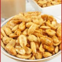 Roasted, salty and sweet nuts all served up in a gold rimmed bowl.