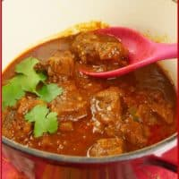 Goan Pork Vindaloo A pork masala served in a beautiful red dutch oven. Rich with spices and chilies, a curry of your dreams