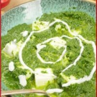 Palak Paneer Served with a dusting of fresh cilantro with white cubes of paneer peaking out of the bright green sauce.