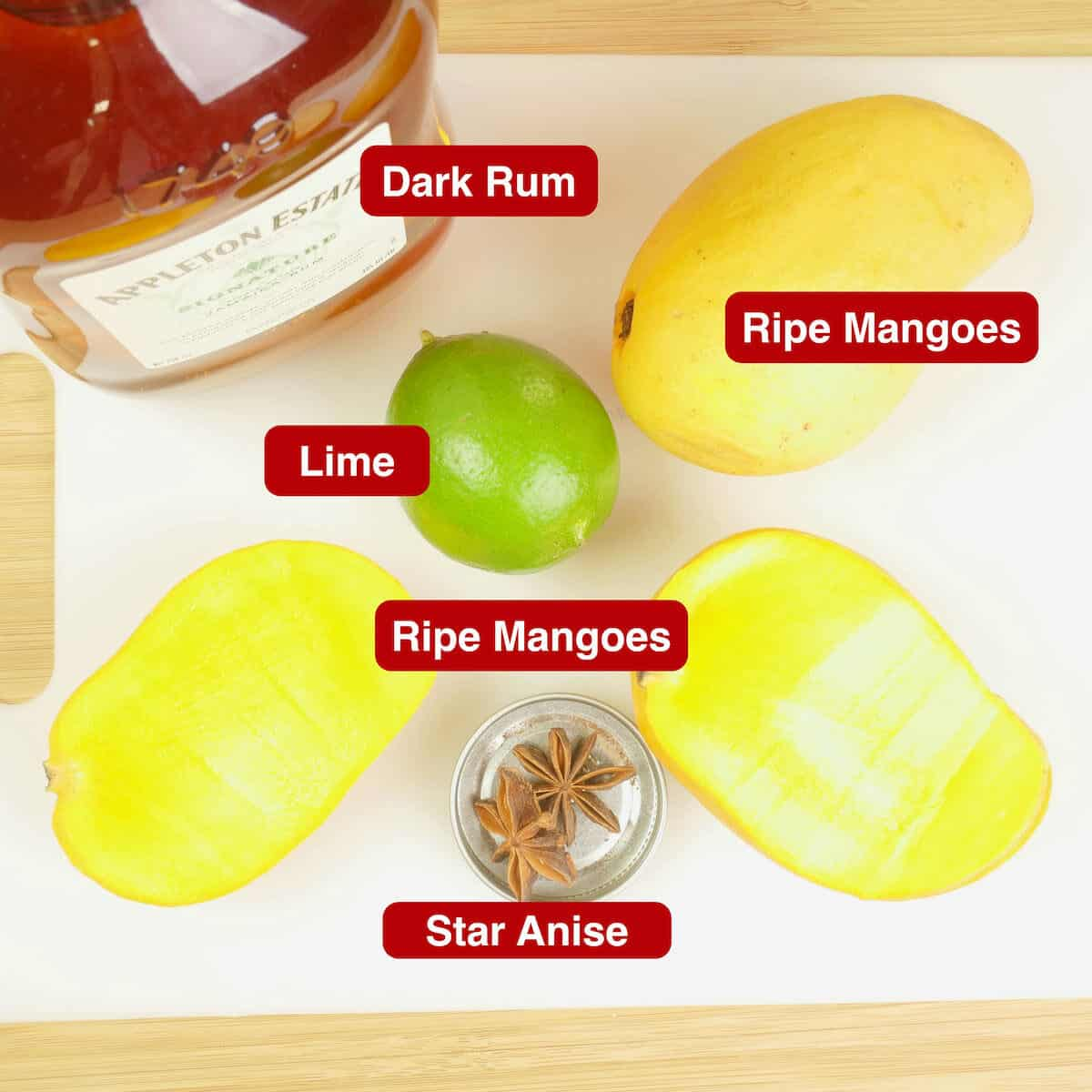The ingredients for mango liqueur gathered and on a cutting board.