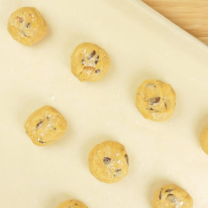 Almond Flour Chocolate Chip Cookies Cookies shaped into balls and slightly flattened.