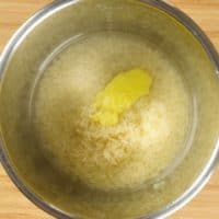Fluffy Basmati Rice Two Ways Rice, salt, ghee and water in the Instant Pot ready for cooking.