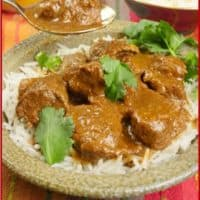 Fragrant Rogan Josh Curry Served on a bed of fluffy basmati rice and garnished with a fluttering of bright green cilantro.