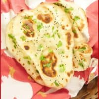 Served in a basket garnished with a flutter of chopped cilantro and sprinkling of onion or nigella seeds.