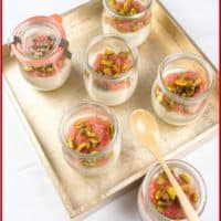 Indian-ish Coconut Custard Served in small glass jars and topped with grapefruit and candied pistachios.
