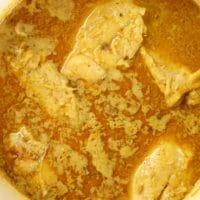 Curry is cooked in a dutch oven and ready for serving.