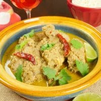Goan Chicken Curry (Xacuti) - Served with a flutter of green cilantro and dried red chilies.
