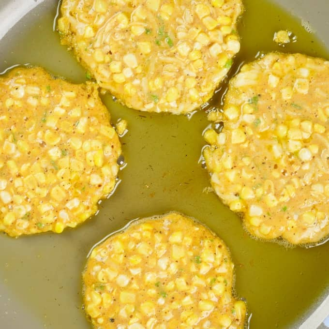 Sweet Corn Cakes - In the frying pan on side one.