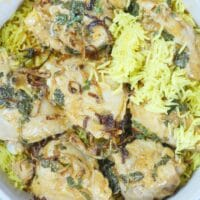 Goan Chicken Biryani - The layering of the cooked chicken and cooked rice begins.