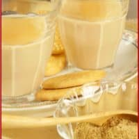 Alonna's Chai Recipe - Two cups of chai served with Marie biscuits on a pretty plate.