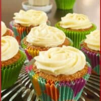 Baked in pretty cupcake papers and frosting with swirls of cream cheese frosting.