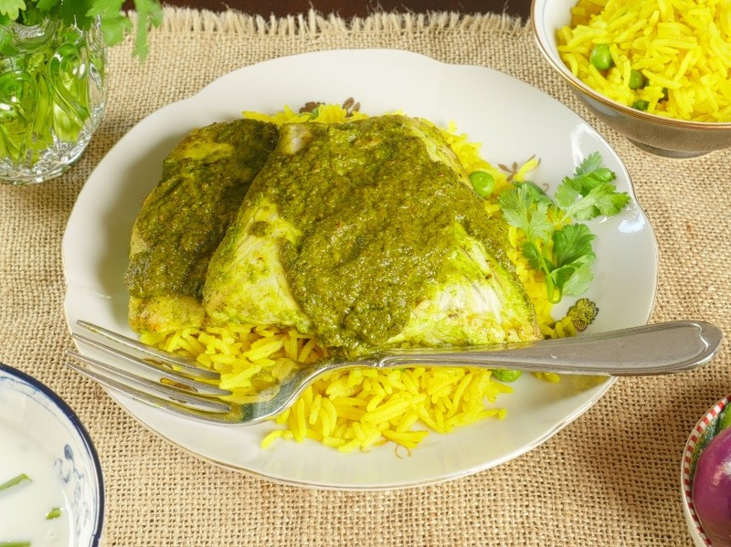 Indian Fish Curry (Recheado) Served on top of Goan rice and drizzled with reduced marinade.