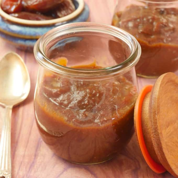 Tangy Tamarind Date Chutney Stored in a pretty tulip-shaped weck jar with a wooden lid and a side bowl of whole dates.