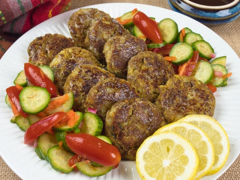 Indian-Spiced Kabab Recipe ~ Served snack-sized with a side of tomato and cucumber salad and wedges of lemon.