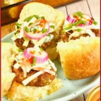 Indian Homemade Chorizo ~ Made into cute little sliders topped with a slaw, pickled red onions, and a drizzle of red and green chutneys.