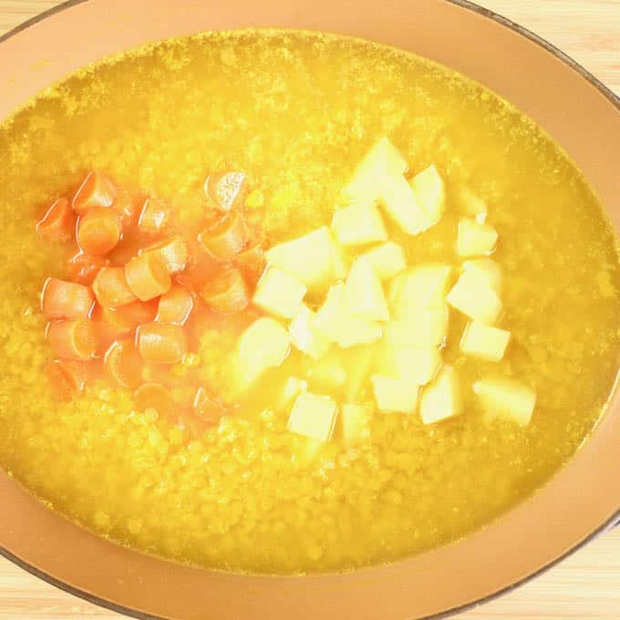 Glorious Chicken Mulligatawny Soup Lentils cooking and the carrots and potatoes added.