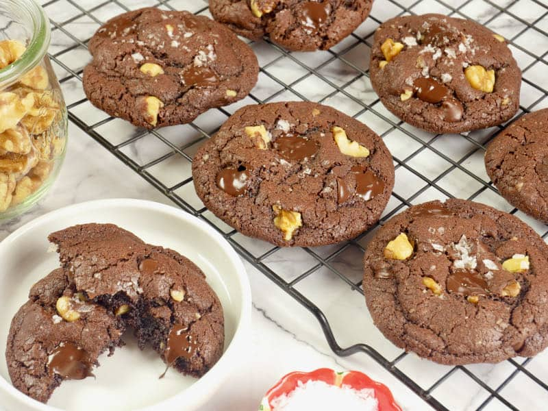 Spicy Chocolate Cookies ~ Cookies baked and cooking on a rack, the chocolate all melty and dusted with a sprinkling of flaky salt.
