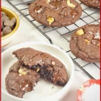 Cookies baked and cooking on a rack, the chocolate all melty and dusted with a sprinkling of flaky salt.